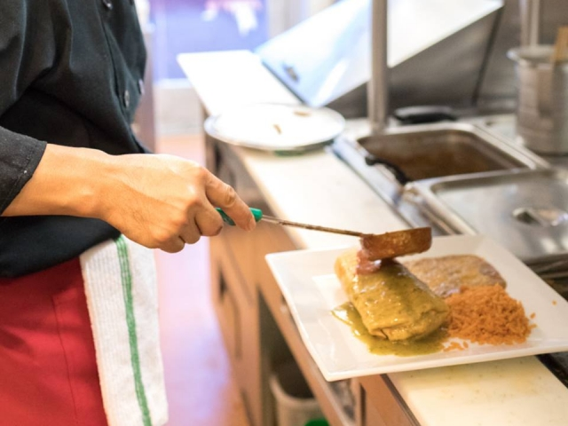 Making Your Enchiladas at Brodys Mexican Restaurant